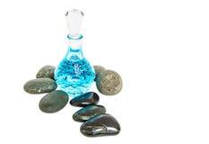 Perfume Bottle and Zen Stone VI Royalty Free Stock Photos