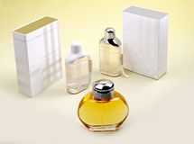 Perfume bottles. And its packaging box on background Royalty Free Stock Photography