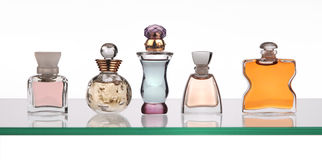 Perfume bottles. On glass shelf Stock Images