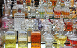 Perfume bottles. At a market stall in Mysore, India ... personalized perfume can be mixed from these fragrances Royalty Free Stock Images