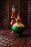 Perfume bottles. Egyptian perfume bottles in warm romantic setting stock image