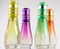 Perfume Bottles. Four bottles of perfume -isolated stock images