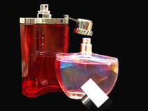 Perfume Bottles. Two different shaped perfume bottles wit open lids Stock Photography