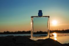 Male perfume. Perfume bottles against the evening sunset. female beauty concept royalty free stock images