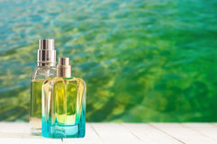 Perfume bottles against sea Stock Photography