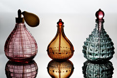 Perfume Bottles. Container for perfume with reflection Royalty Free Stock Photo