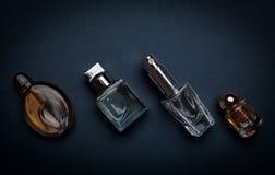 perfume bottles on the dark background Stock Photo
