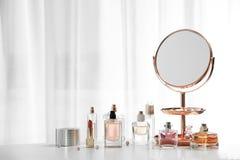 Perfume bottles on table. Perfume bottles on dressing table stock photos
