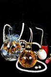 Perfume bottles and jewellery. Royalty Free Stock Photography