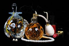 Perfume bottles, jewellery and make-up. Stock Images