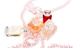 Perfume bottles and necklace stock photos