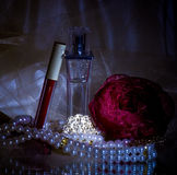 Perfume bottles, red lipstick Stock Image