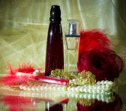 Perfume bottles, red lipstick, feather, rose Royalty Free Stock Photography
