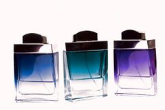 Perfume bottles with reflection Royalty Free Stock Photos