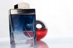 Perfume bottles with reflection Stock Images