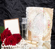 Perfume bottles,roses and with wedding rings Royalty Free Stock Photo