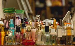Perfume bottles on the shelf Royalty Free Stock Image