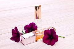 Perfume bottles surrounded by flowers Stock Image