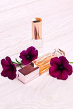 Perfume bottles surrounded by flowers Royalty Free Stock Images