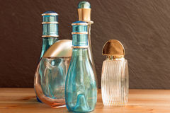 Perfume bottles on table. Closeup of perfume bottles on wooden table studio shot Royalty Free Stock Photo