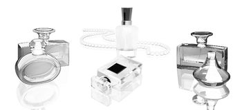 Perfume bottles  on white  background with reflection. Royalty Free Stock Photo