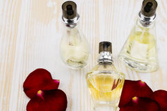Perfume bottles on wooden background Royalty Free Stock Images