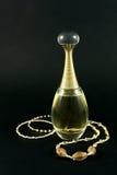 Perfume, bracelete e colar Foto de Stock Royalty Free