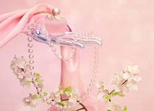 Perfume, a branch of Apple blossoms, beads and pink silk scarf i Stock Photos