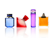 Perfume color glass bottles isolated on white. Royalty Free Stock Photos