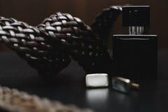 Perfume con la correa y el puño Fotos de archivo libres de regalías