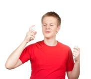 Perfume de la fragancia del adolescente del muchacho que pinta (con vaporizador) Fotografía de archivo