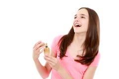 Perfume de rogación de la muchacha adolescente de la botella Imagen de archivo libre de regalías