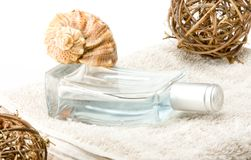 Perfume with decorations. Perfume with decoration on a towel Royalty Free Stock Photography