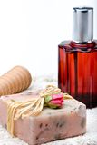 Perfume with decorations. Decorative soap on a towel with a perfume Stock Photos