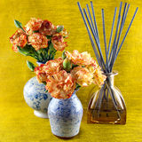 Perfume diffuser and flowers Stock Photos