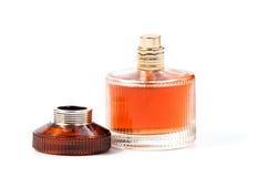 Perfume do ` s das mulheres na garrafa bonita isolada Imagens de Stock