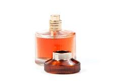 Perfume do ` s das mulheres na garrafa bonita isolada Foto de Stock