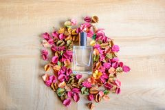 Perfume and dried flowers stock images