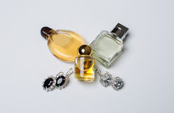 Perfume and earrings Royalty Free Stock Images