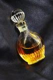 Perfume en el cuero Imagenes de archivo
