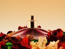Perfume and flowers Stock Photography
