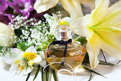 Perfume and flowers Royalty Free Stock Photography