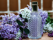 Perfume with flowers Royalty Free Stock Photography