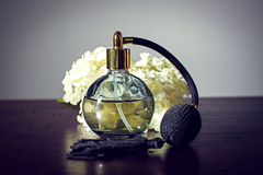 Perfume and flowers Stock Image