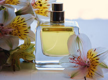 Perfume with flowers Stock Images