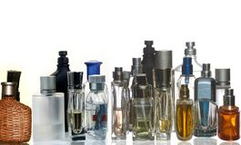 Perfume and fragrance bottles with reflection. Colorful perfume bottles  in white : Note to reviewer: remove trace of copyright trademark and infringement Royalty Free Stock Photo