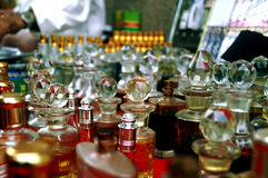 Perfume and fragrance. Defocused and toned fragrance bottles in store display Royalty Free Stock Image