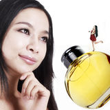 Perfume girls. Happy perfume girls with their favorite perfume on white Royalty Free Stock Photo