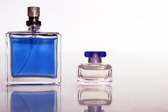 Perfume in a glass bottle. And his reflection Stock Images