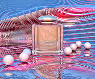 Perfume in a glass bottles and pearl beads Stock Photo